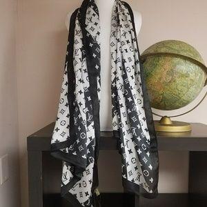 New large silk Louis Vuitton scarf.